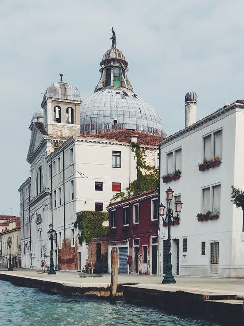 Gray Dome Building Beside Canal