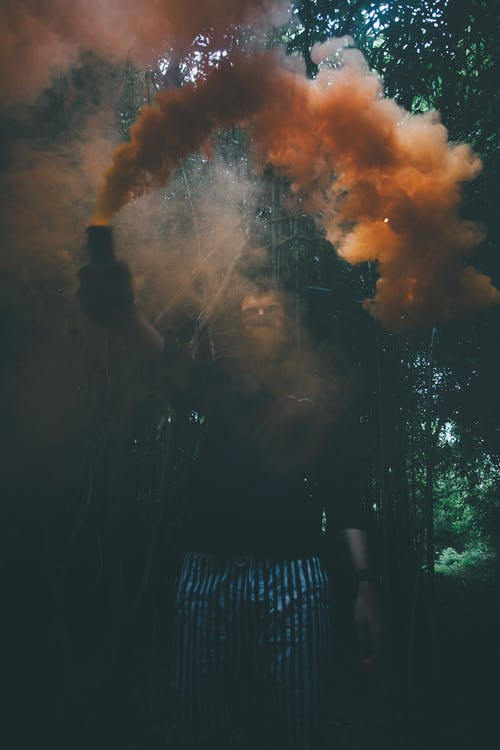 Photo Of Man Holding Smoke Bomb