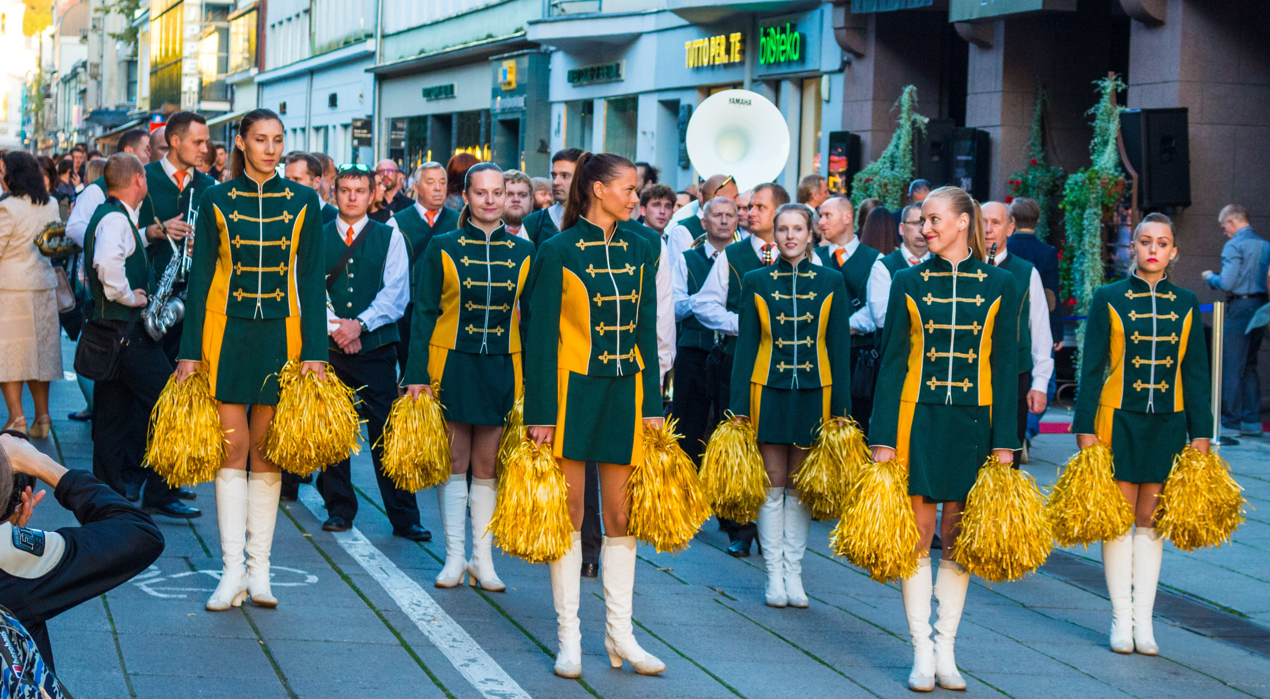 Landscape Photography of Cheerleader Parade on Road