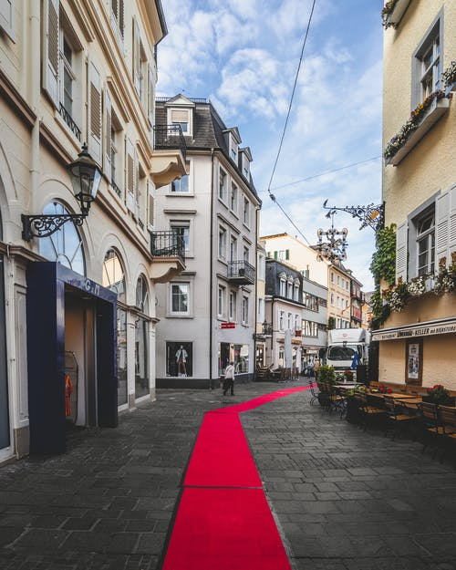 Red Carpet in the Middle of Road Between Buildings
