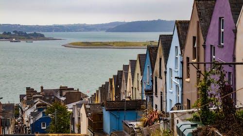 다채로운 주택, 바다, 색깔, 컬러풀한 집의 무료 스톡 사진