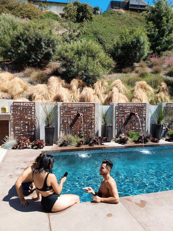 Sitting Woman Wearing Black Bikini Beside Pool