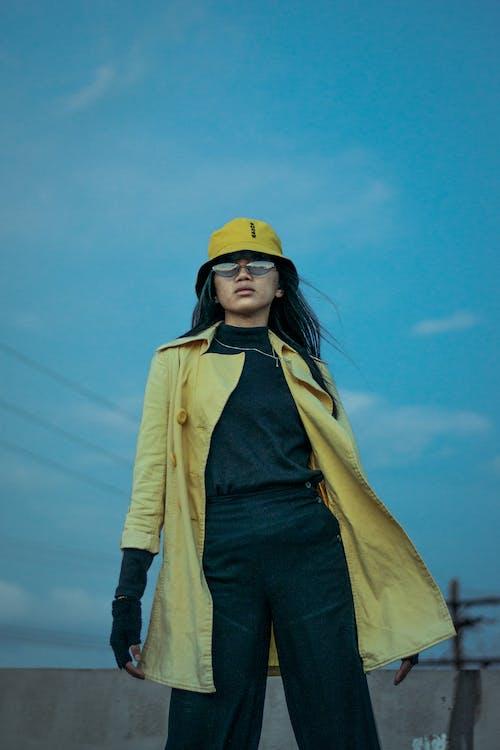 Woman Standing Outdoor Wearing Yellow Bucket Hat