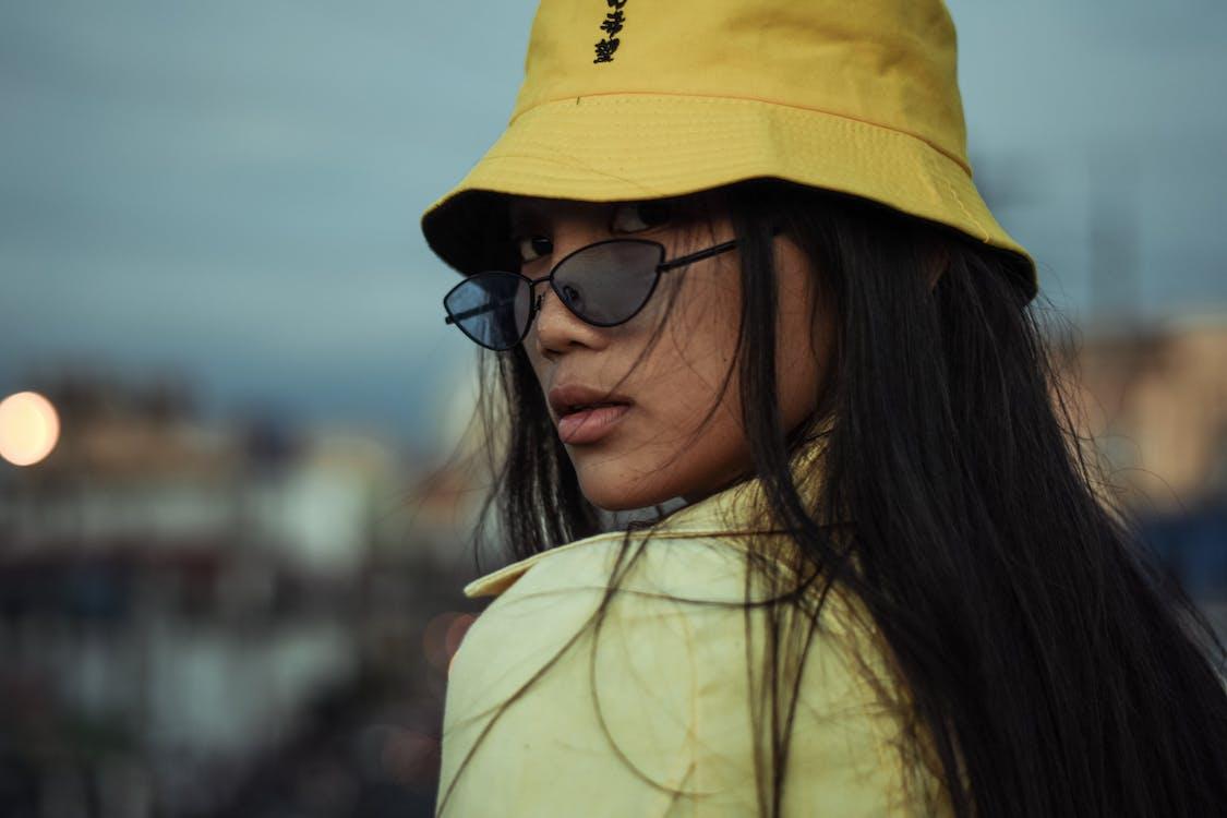 Woman Wears Yellow Bucket Hat