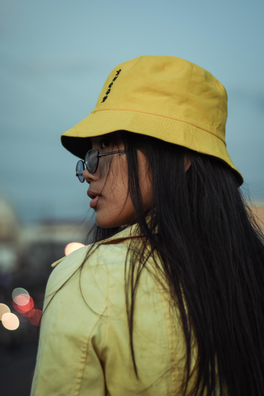 Woman In Sunglasses Wearing Yellow Bucket Hat Free Stock Photo