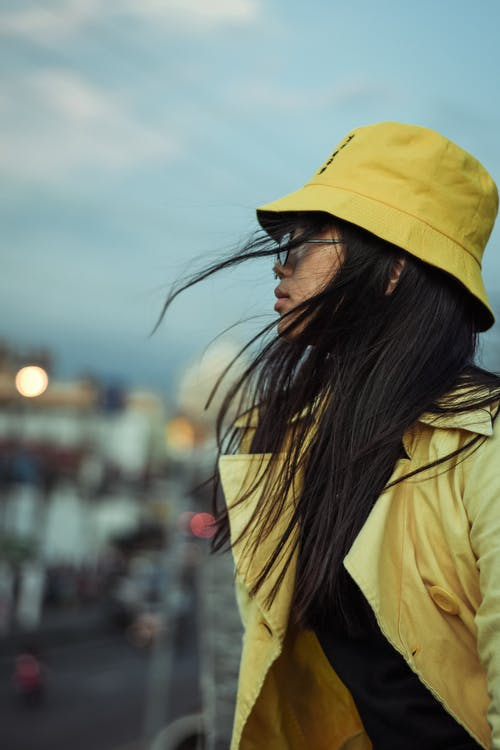 Woman Wearing Yellow Jacket and Yellow Bucket Hat