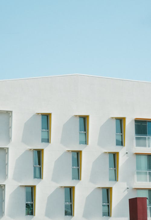 White Concrete Building With Glass Windows