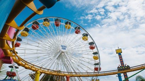 Ferris Wheels Under Blue Sky