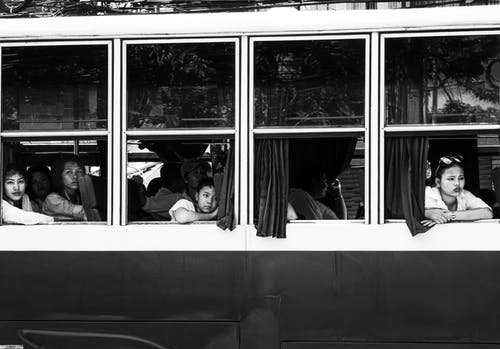 Grayscale Photo Of People Inside Bus