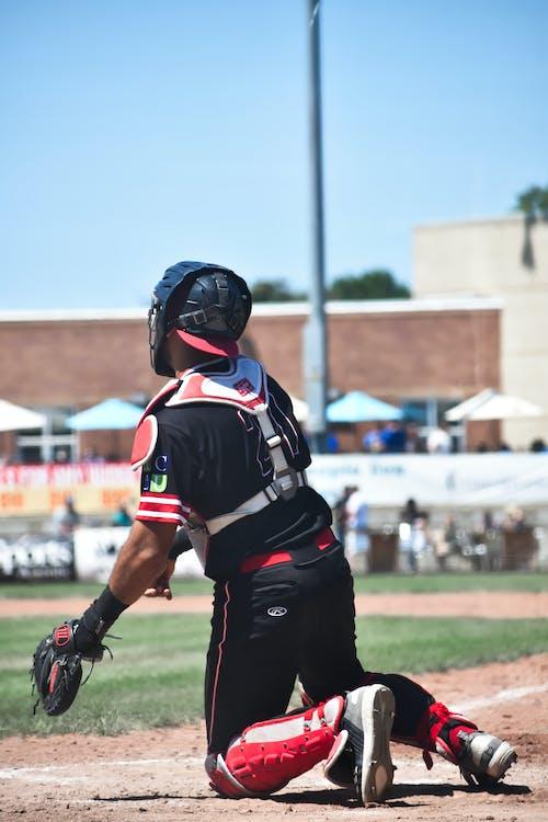 Безкоштовне стокове фото на тему «бейсбол, бейсболіст, бейсбольний видовище, чорна форма»