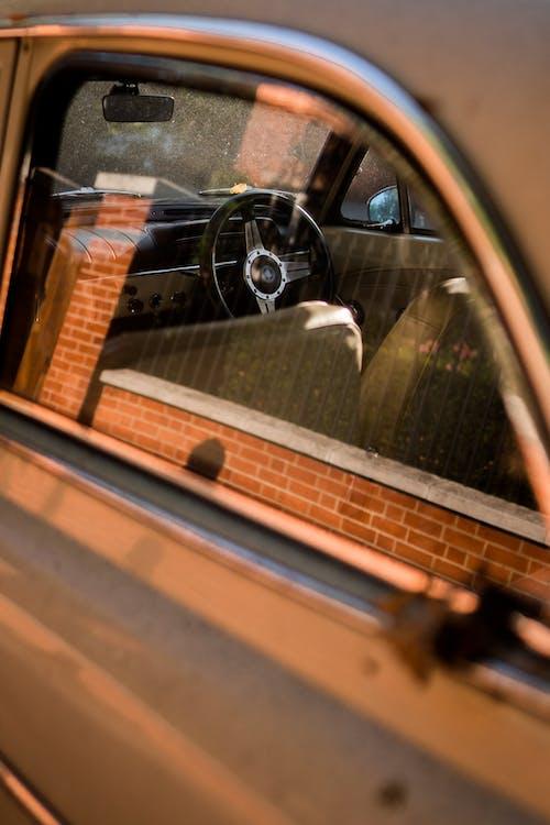 Selective Focus Photo of Steering Wheel