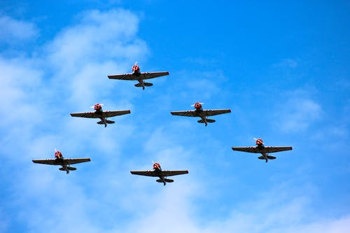 Six Aircrafts in Formation Flying in the Skies