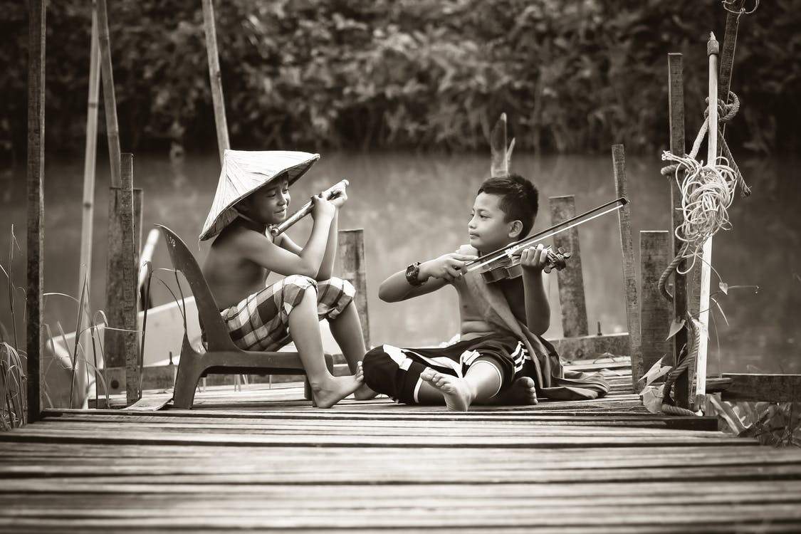 Two Boys Playing Music Instruments