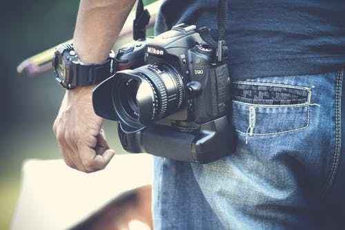 Selective Focus Photography of Man With Black Nikon Dslr Camera