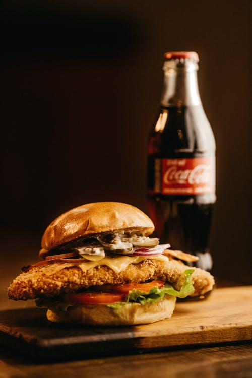Close-Up Photo Of Burger Beside Coca-Cola
