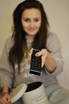 Free stock photo of woman, girl, remote, watching