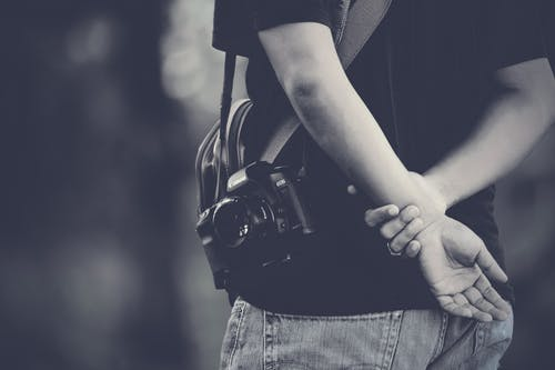Grayscale Photography of Man Wearing Camera