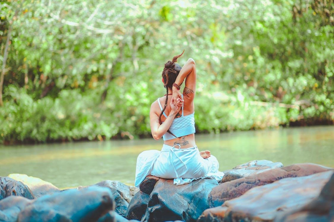 Woman Sitting on Stones