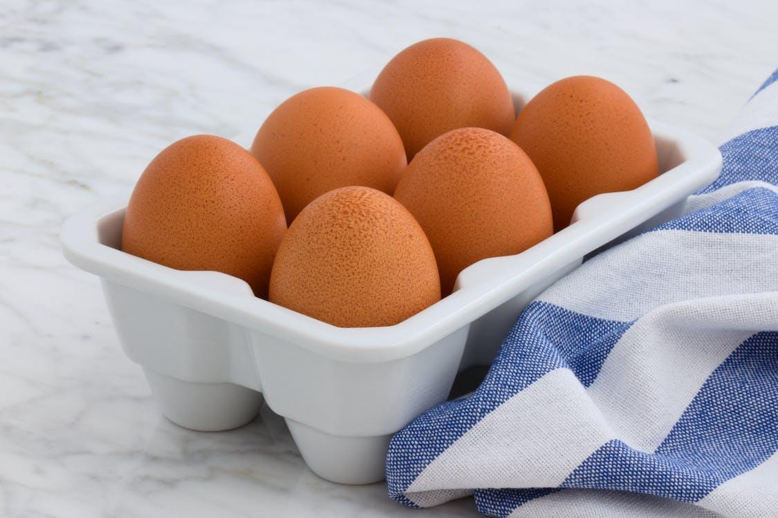Six Organic Eggs on White Tray
