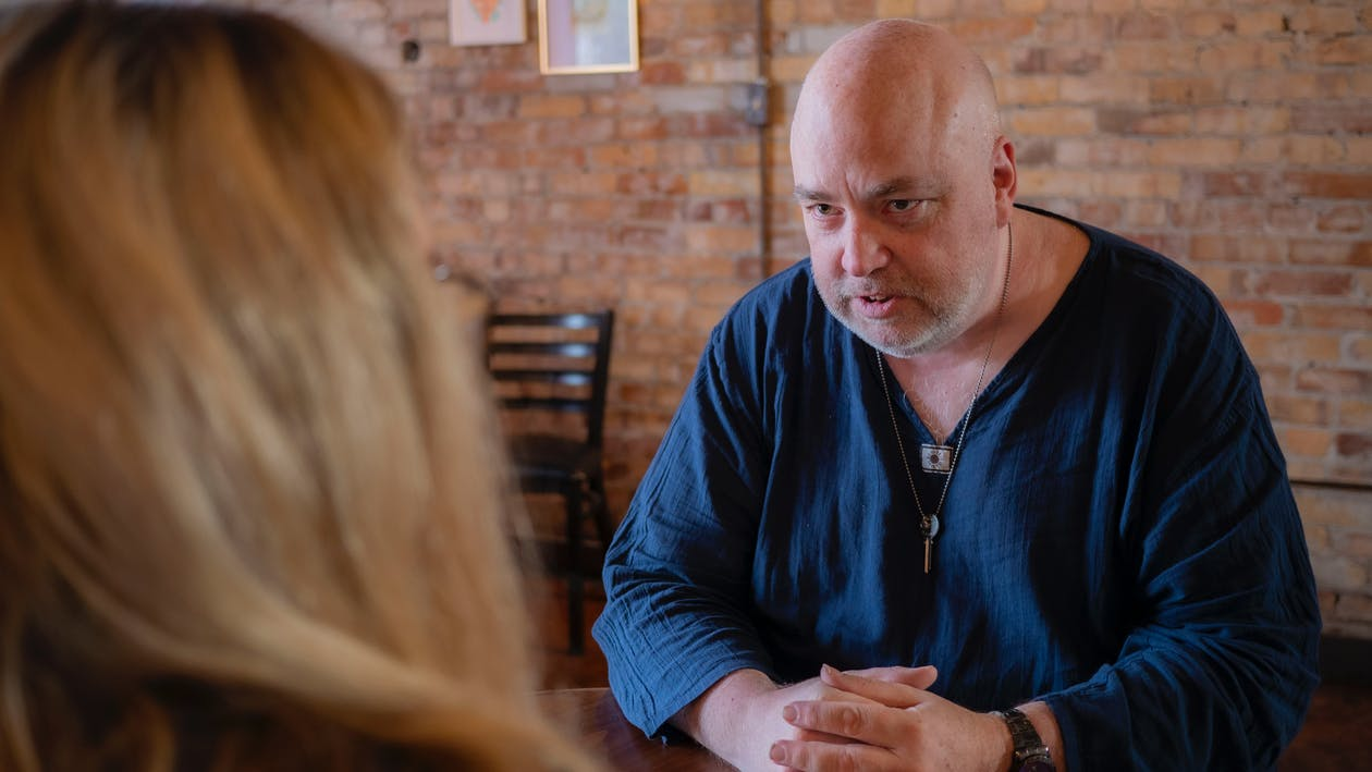 Angry mature man arguing with woman in cafe