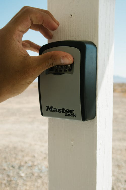 Person Using Master Lock Combination Lock