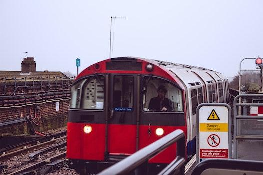 Free stock photo of red, train, public transportation, stones