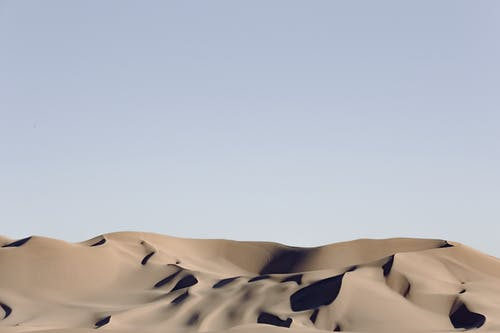 Gray Desert Under Blue Sky