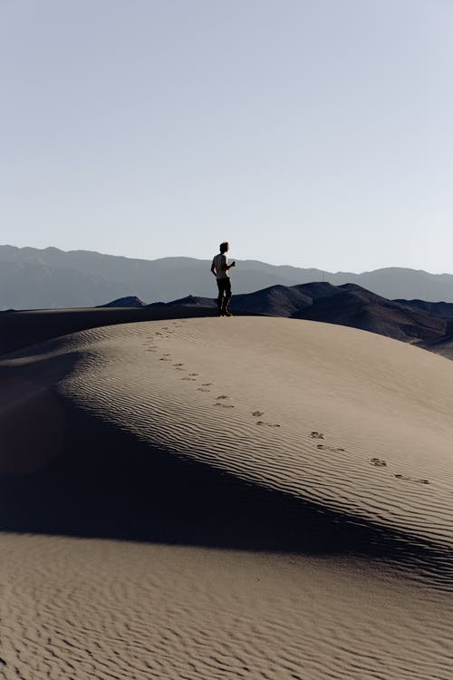 Man Standing on Sand dunes