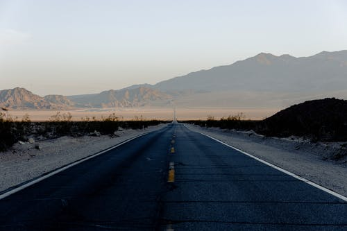 Landscape Photography of Gray Asphalted Road and Mountain Views