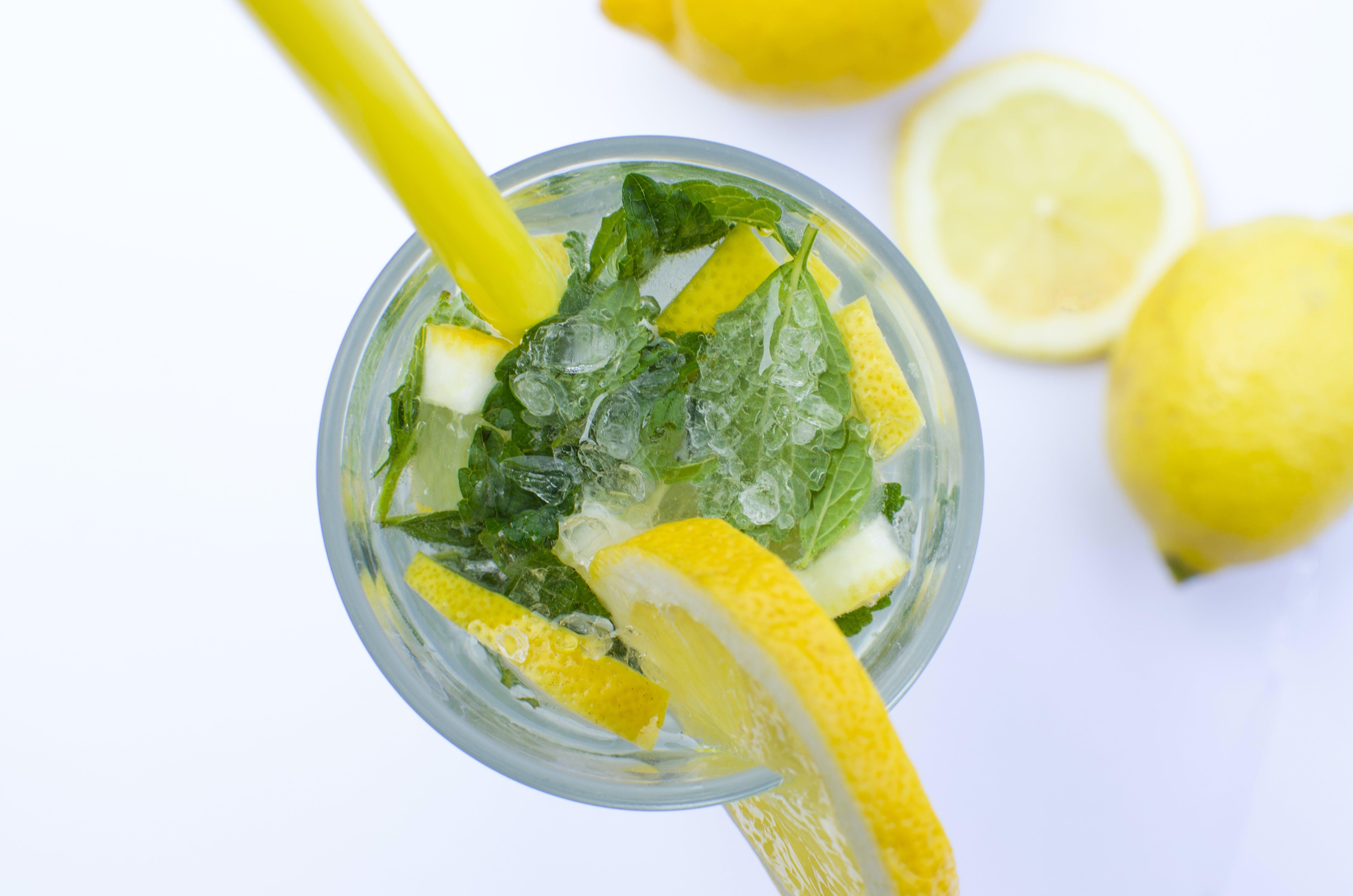 Flat Lay Photograph of Highball Glass With Sliced Lemon