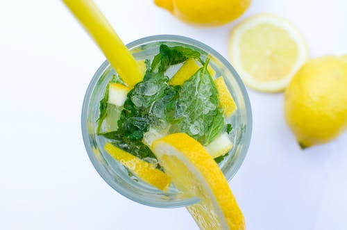 Flat Lay Photograph of Highball Glass With Sliced Lemon