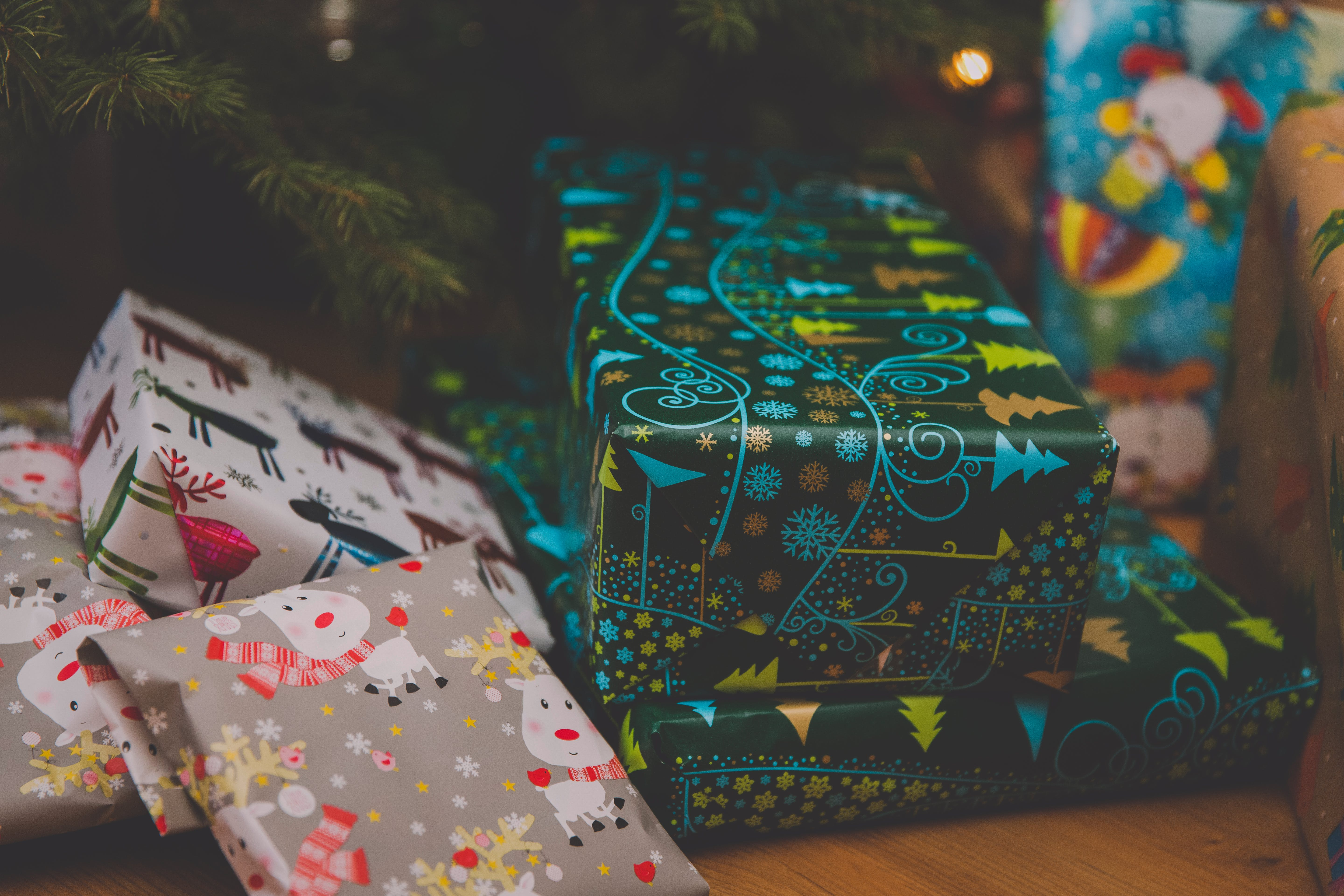 Several Gift Boxes Beside Christmas Tree
