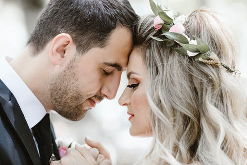 Close-Up Photo Of Bride And Groom