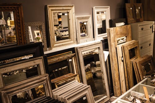 Brown Wooden Framed Mirror Lot Near Wall
