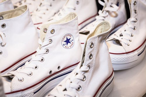 Two Pairs of White-and-red Converse All-star Shoes