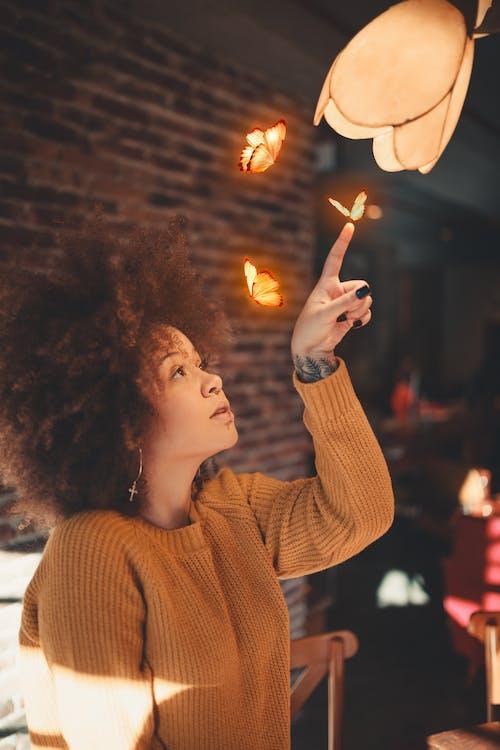 Photo of Woman Wearing Brown Sweater