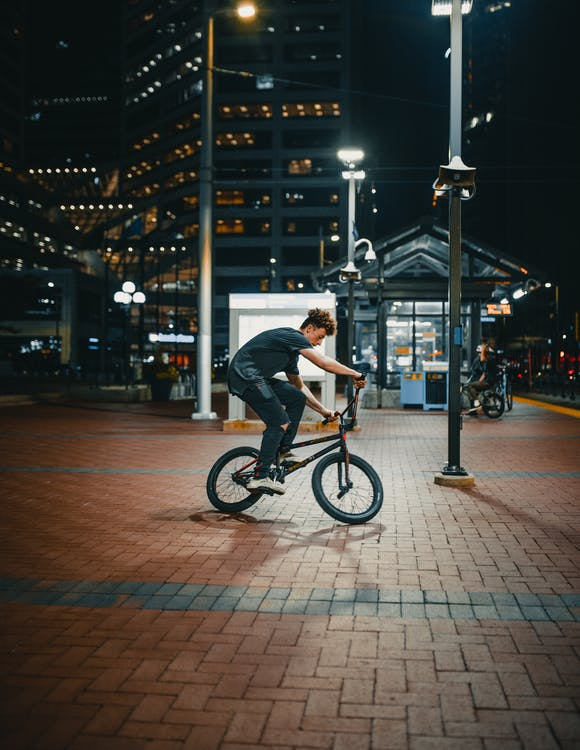 Photo Of Man Riding Bicycle