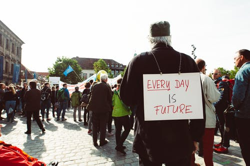 Free stock photo of activists, climate activist, cobblestone street, demonstration