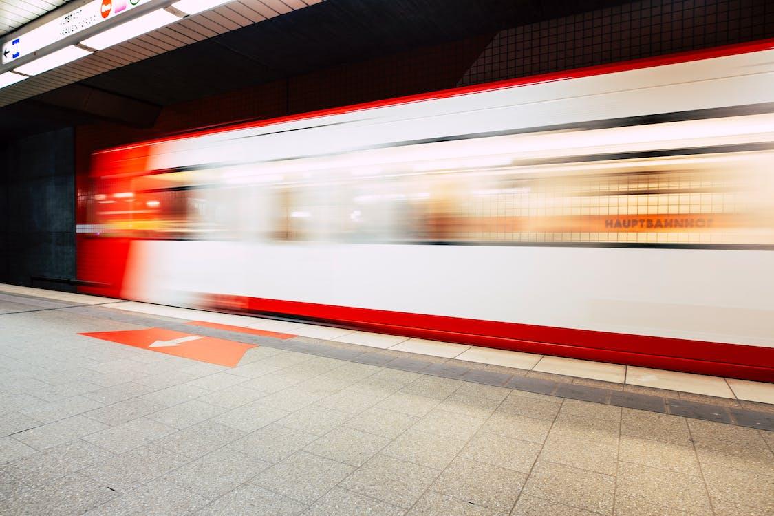 White and Red Subway Train