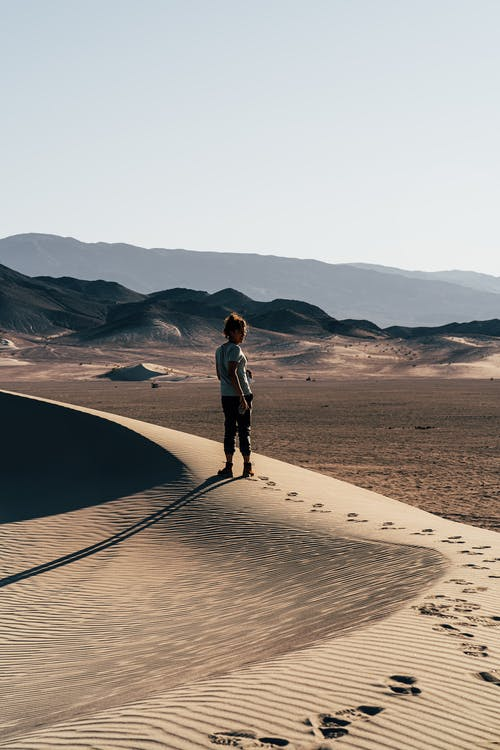 Woman Standing on Desert