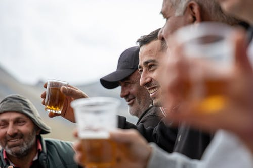 Photo Of Men Drinking Beer
