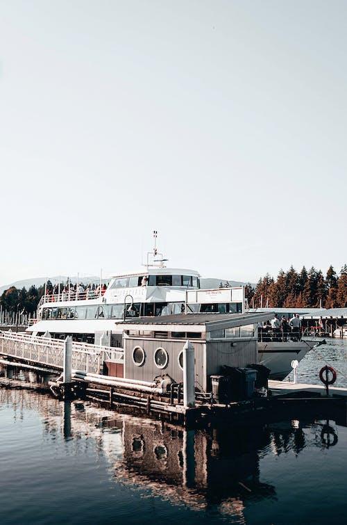 White and Black Yacht Under White Sky