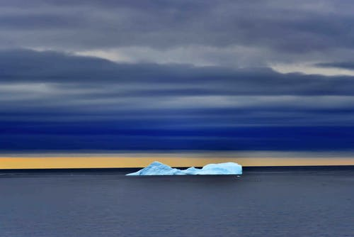 Body of Water With Iceberg