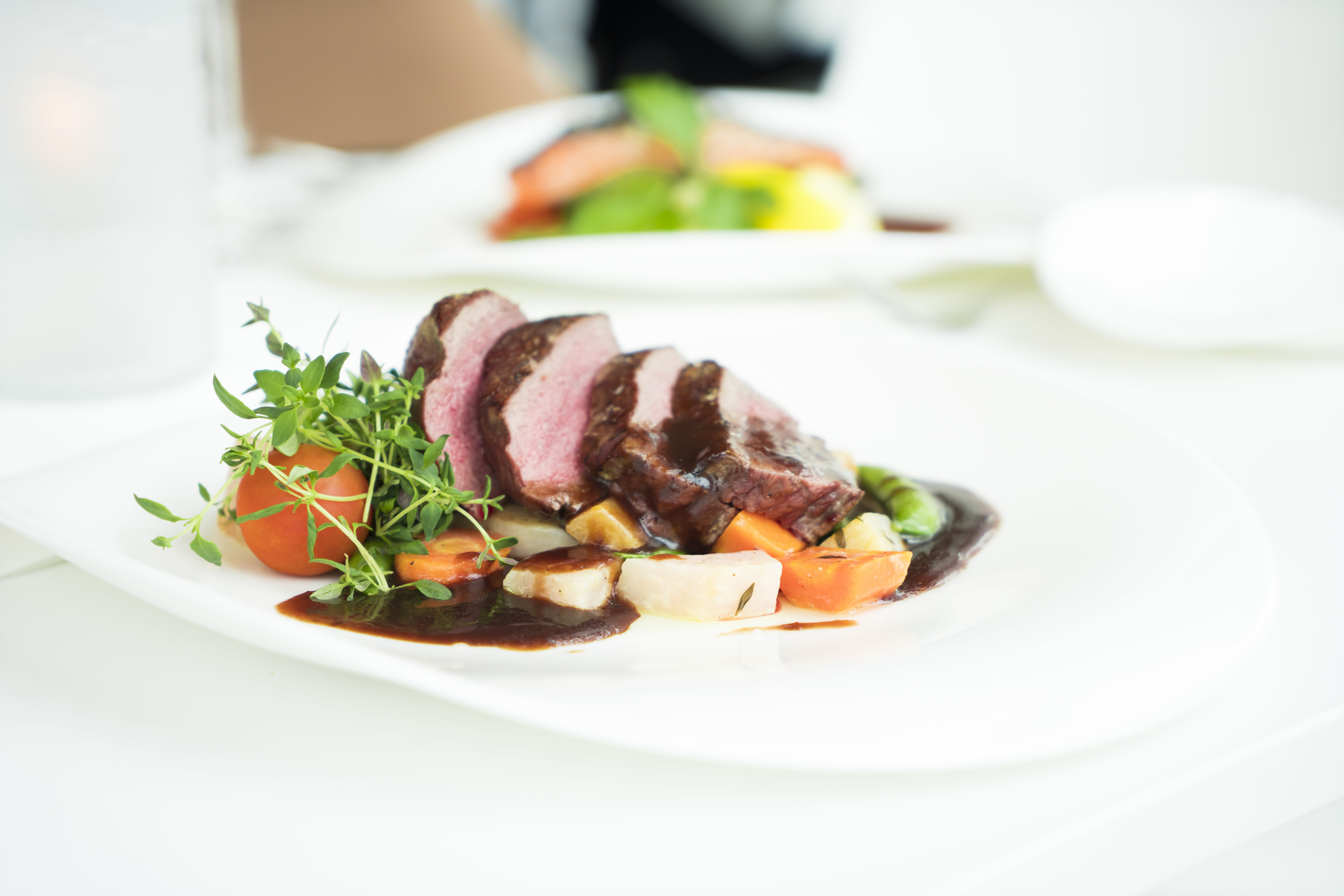 Well-done Beef Steak and Vegetables on Plate