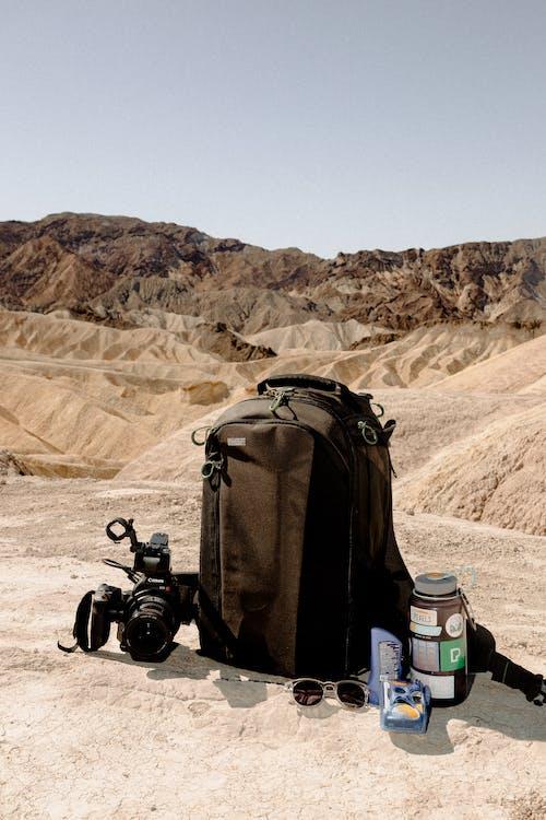 Black Backpack And Black Dslr Camera