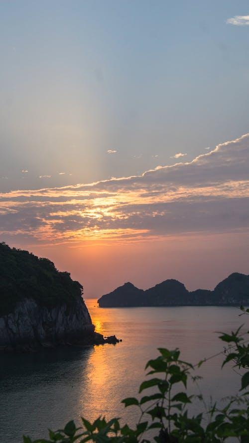 Gratis lagerfoto af ha lang bay, kalksten, smuk solnedgang, strand
