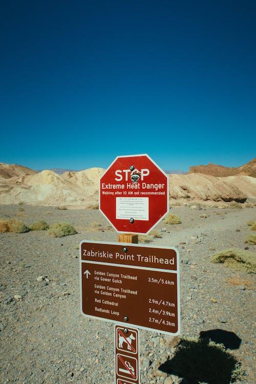 Stop Signboard on Rocky Field