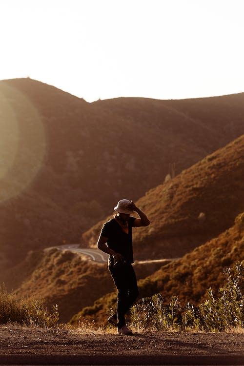 Man Walking Near Hill