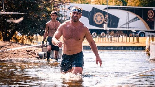Men Walking in Water