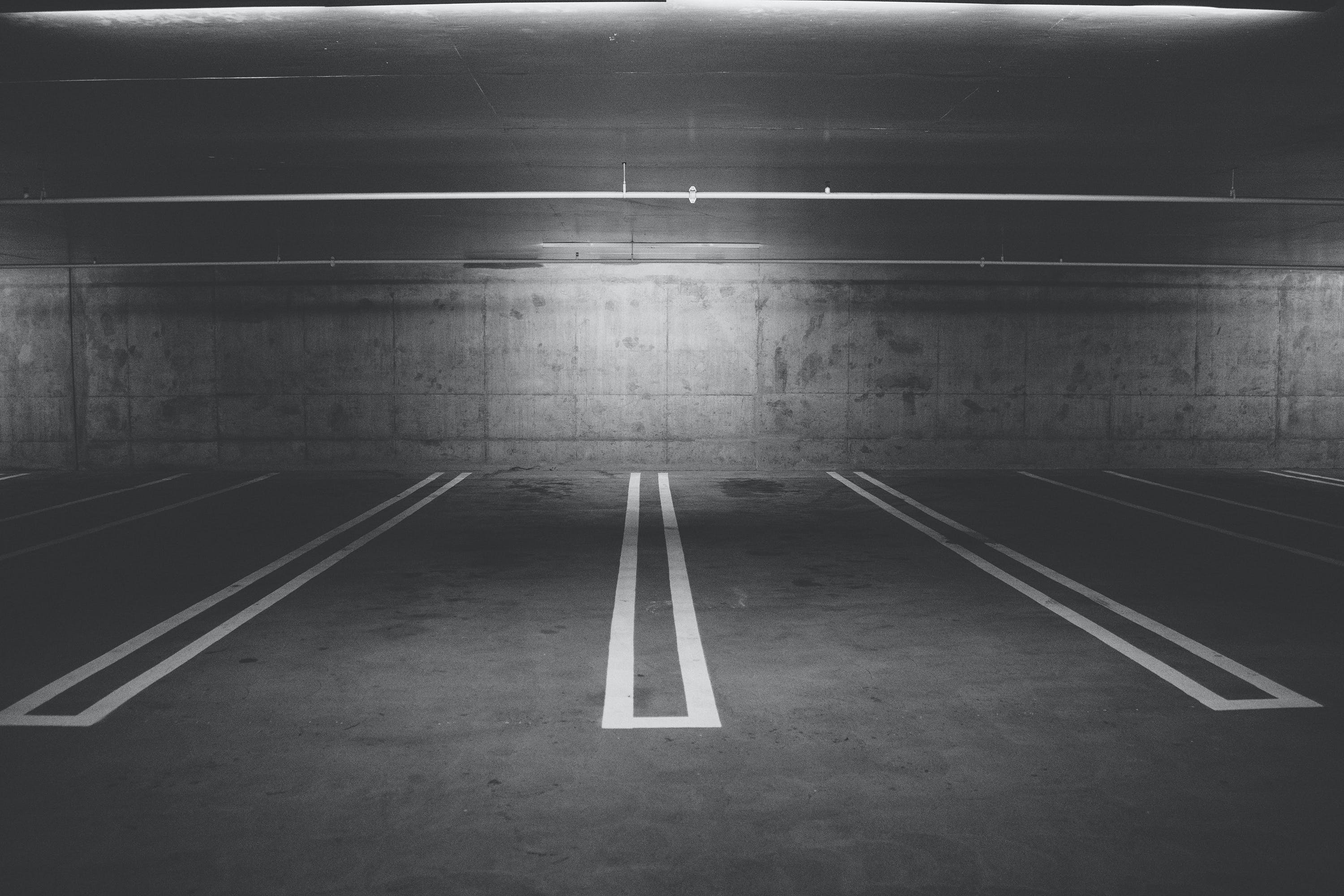 Grayscale Photography of Empty Parking Lot